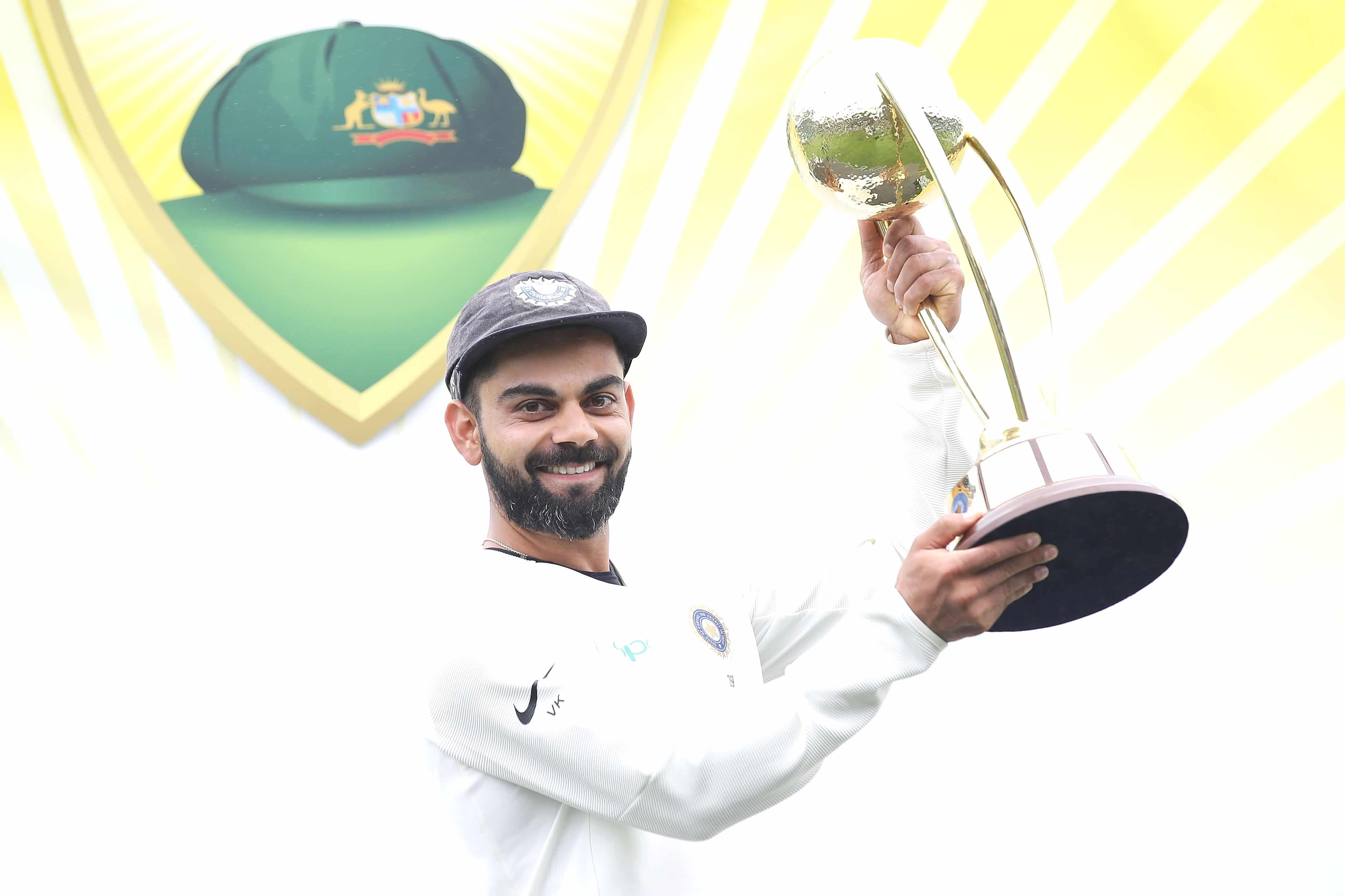 Virat Kohli of India poses with the Border–Gavaskar Trophy as he celebrates India's 2-1 series win after day five of the Fourth Test match in the series between Australia and India at Sydney Cricket Ground on January 07, 2019 in Sydney, Australia. (Photo by Mark Kolbe/Getty Images)