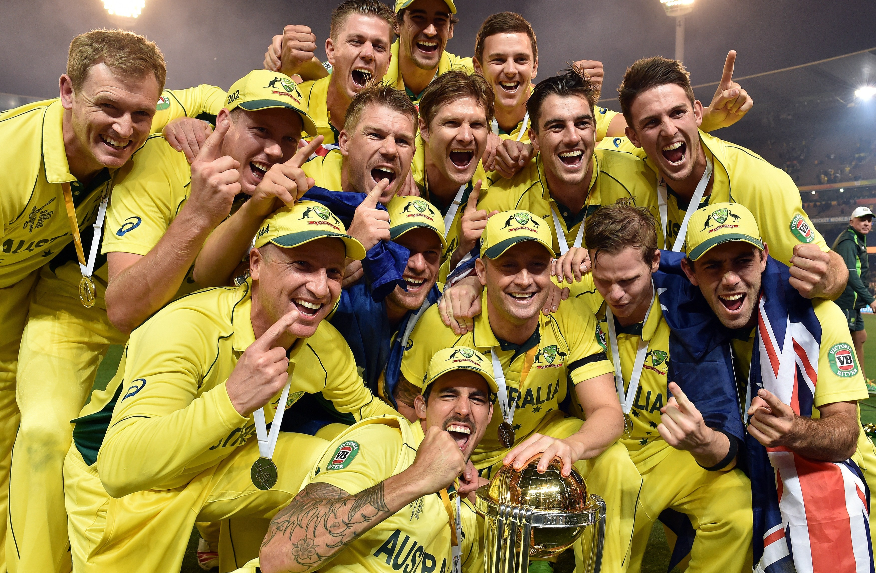 Australian cricketers celebrate with the trophy after the winning the 2015 Cricket World Cup final between Australia and New Zealand in Melbourne on March 29, 2015. AFP PHOTO / SAEED KHAN --IMAGE RESTRICTED TO EDITORIAL USE - STRICTLY NO COMMERCIAL USE--        (Photo credit should read SAEED KHAN/AFP/Getty Images)