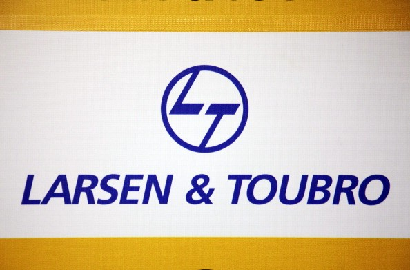 The logo of Larsen & Toubro Ltd. is displayed during a news conference at the company's headquarters in Mumbai, India, on Friday, Oct. 21, 2011. Larsen & Toubro Ltd., India's biggest builder of power networks and airports, reported second-quarter profit that beat analysts' estimates. Photographer: Kuni Takahashi/Bloomberg via Getty Images