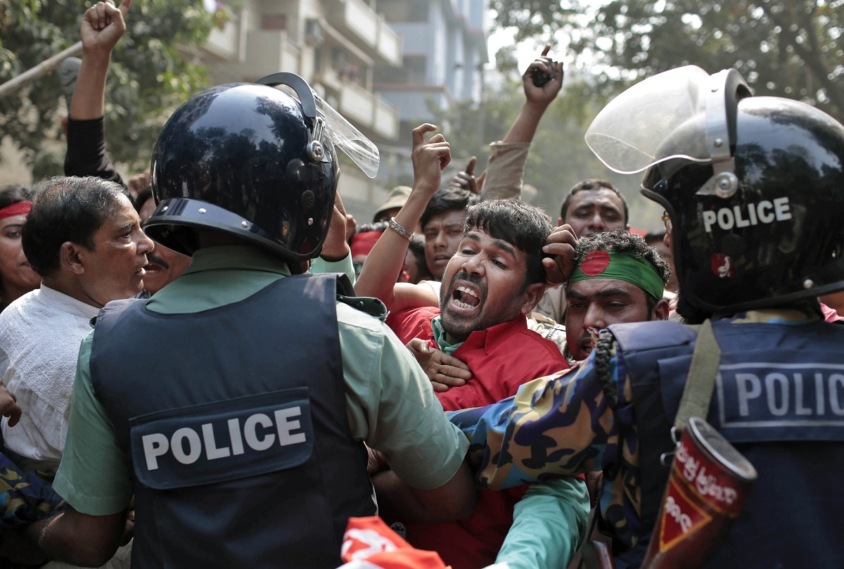 Supporters of National Transport Workers League, a wing of the ruling Awami League party try to break through a police barricade in front of the office of opposition Bangladesh Nationalist Party (BNP) during a demonstration against the ongoing nationwide blockade and strike called by the opposition in Dhaka, Bangladesh, Monday, Feb. 9, 2015. The nationwide transport blockade enforced by BNP since Jan. 6 is to pressurize Prime Minister Sheikh Hasina to resign and announce new elections. (AP Photo/A.M. Ahad)