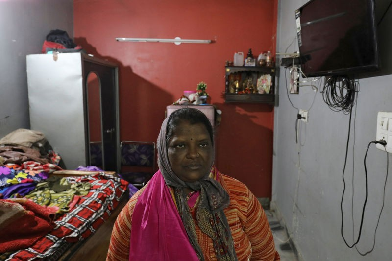 Sugana, mother of Prabhu Dhandapani who was detained by police on the suspicion of being involved in illegally sending people to New Zealand on a boat, looks on inside her house in New Delhi, India, January 23, 2019. Picture taken January 23, 2019. REUTERS/Anushree Fadnavis
