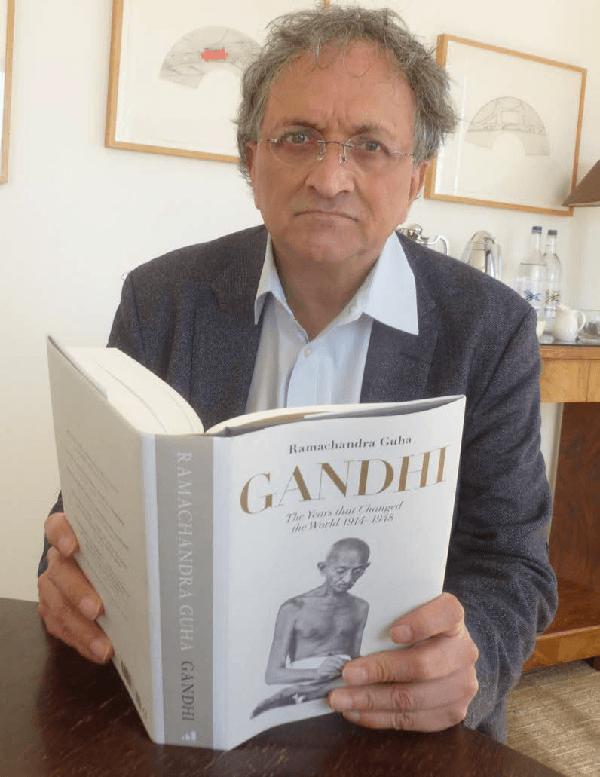 Ramachandra Guha with his book on Gandhi