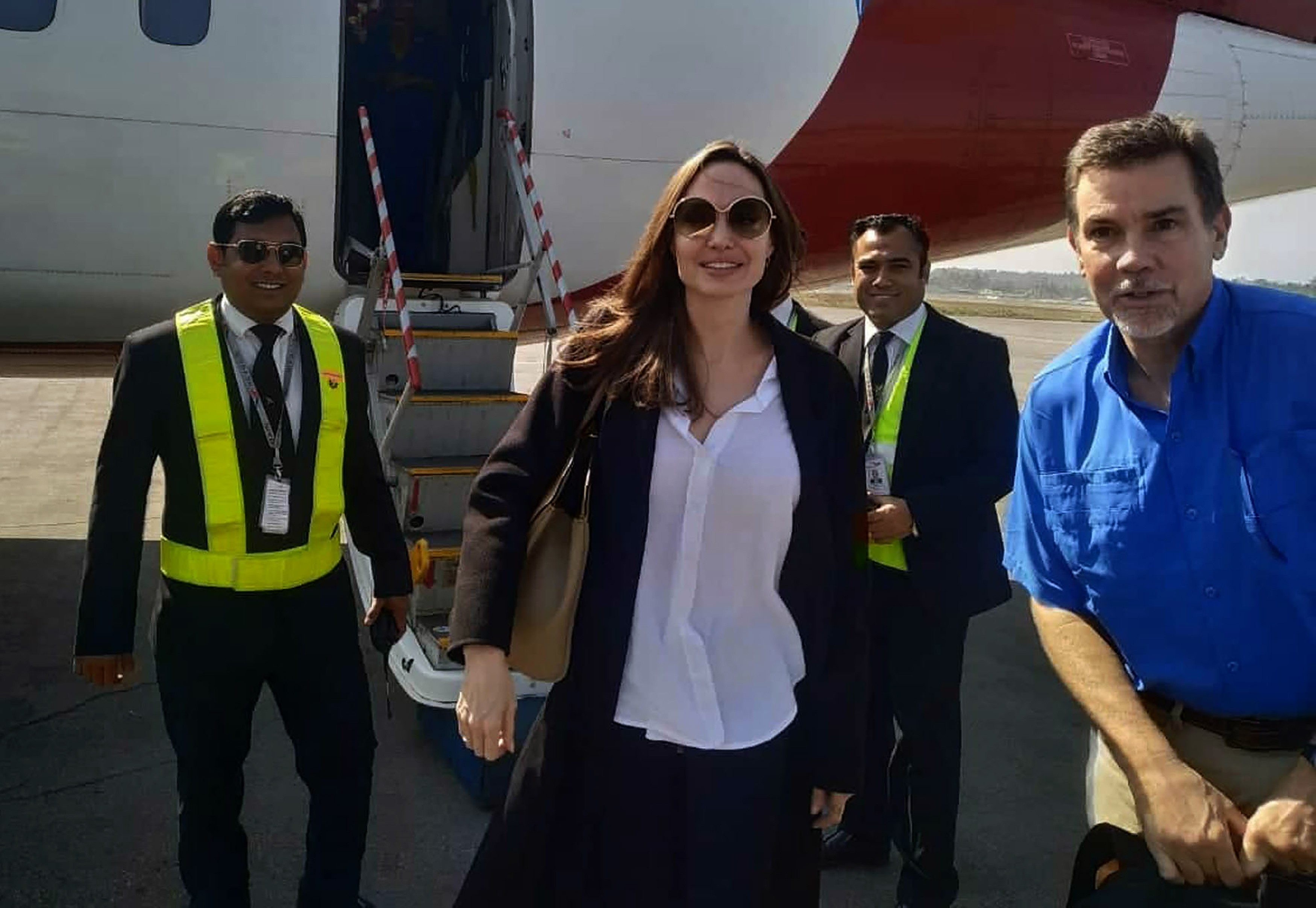 US actress and humanitarian Angelina Jolie, a special envoy for the United Nations High Commissioner for Refugees (UNHCR), arrives at the airport in Cox's Bazar in southern Bangladesh on February 4, 2019, ahead of a visit to nearby Rohingya refugee camps. - UNHCR Special Envoy Angelina Jolie is visiting the refugee camps for Rohingya communities in southern Bangladesh who have fled violence in neighbouring Myanmar. (Photo by      STR/AFP/Getty Images)