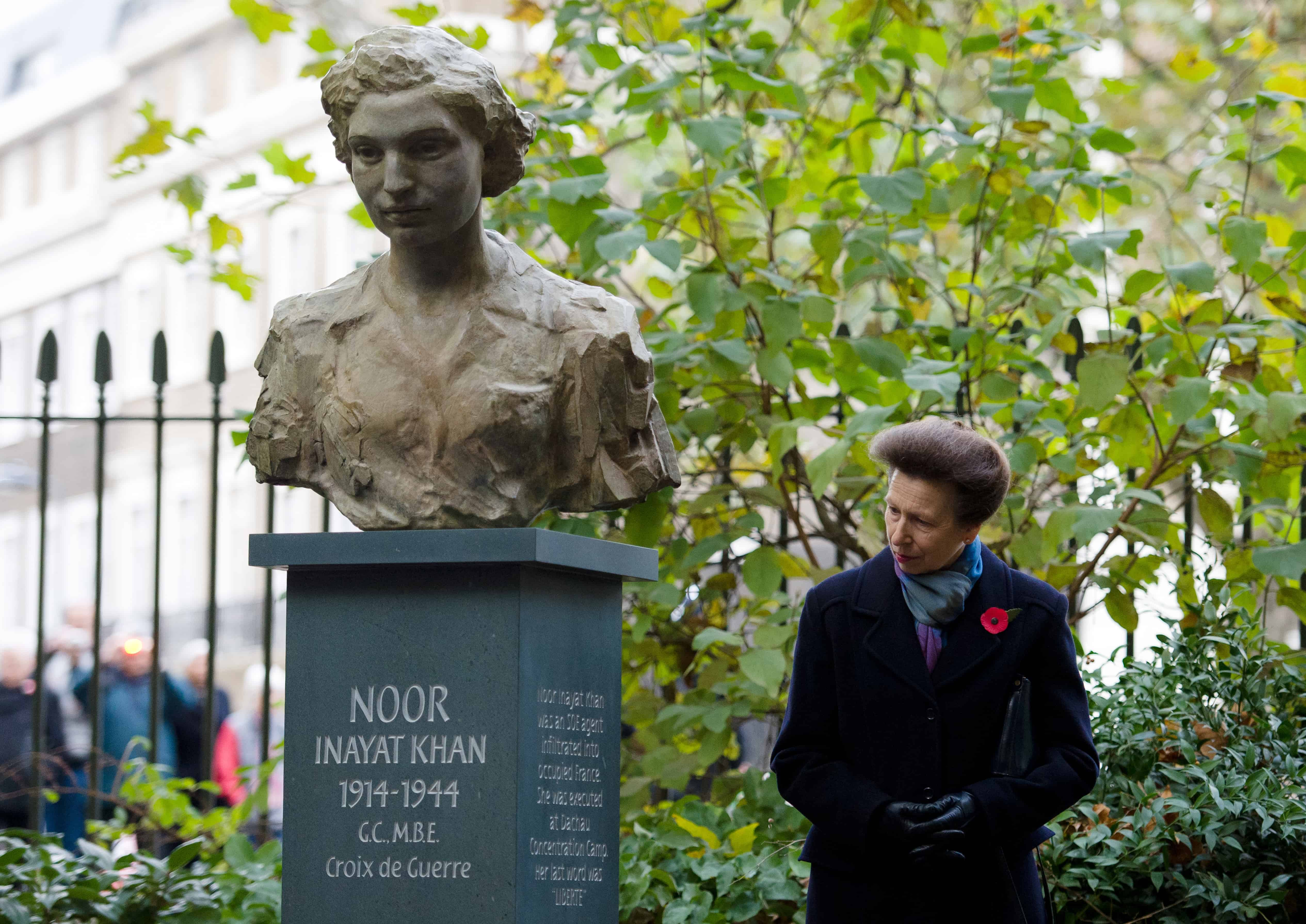 Britain's Princess Anne looks at a sculpture of India's Noor Inayat Khan after an unveiling ceremony in Memorial bust of Inayat Khan in Gordon Square Gardens, London, on November 8, 2012. (LEON NEAL/AFP/Getty Images)