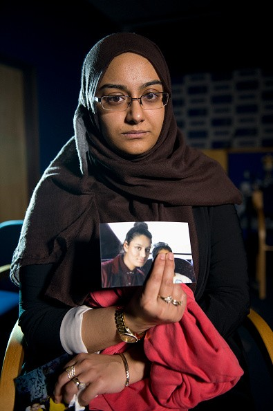 Renu Begum, eldest sister of Shamima Begum, 15, holds her sister's photo as she is interviewed by the media at New Scotland Yard, as the relatives of three missing schoolgirls believed to have fled to Syria to join Islamic State have pleaded for them to return home, on February 22, 2015 in London, England.  (Photo by Laura Lean - WPA Pool/Getty Images)