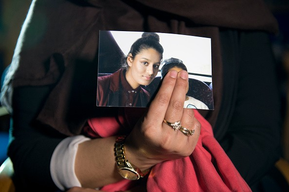 Renu Begum, eldest sister of Shamima Begum, 15, holds her sister's photo. (Photo by Laura Lean - WPA Pool/Getty Images)