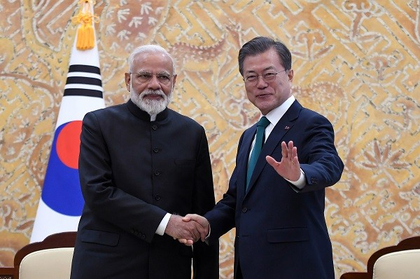 Indian prime minister Narendra Modi shakes hands with South Korea's president Moon Jae-in (R) during their meeting at the presidential Blue House on February 22, 2019 in Seoul. Modi is on a two-day visit to South Korea as part of an effort to strengthen ties between the two countries (Photo: Jung Yeon-Je-Pool/Getty Images).