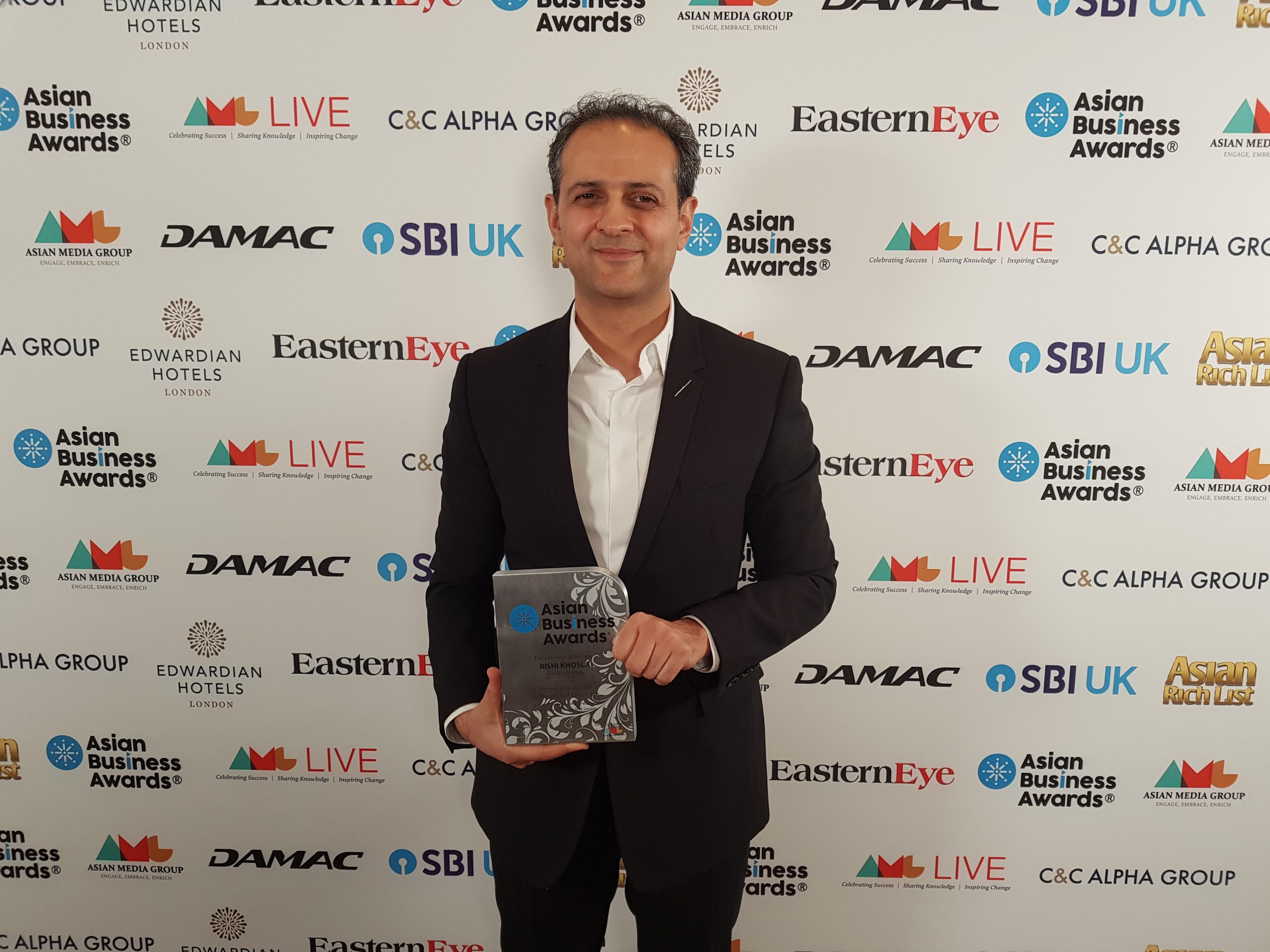 Rishi Khosla collects an award at Asian Business Awards