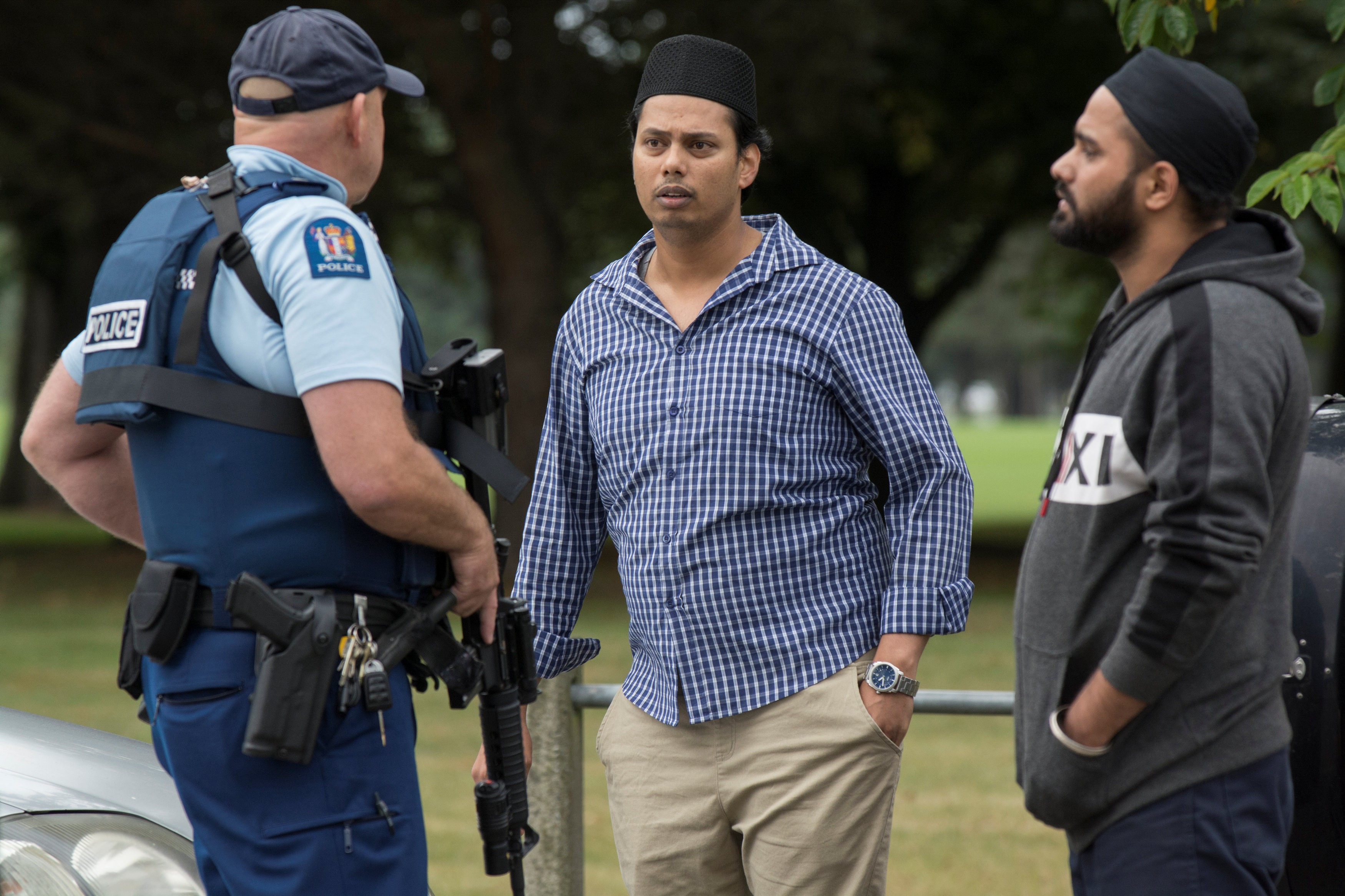 Witnesses and police at the south end of Deans Avenue after a shooting incident at the Al Noor mosque in Christchurch, New Zealand, on March 15