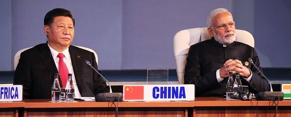 (LtoR) China's President Xi Jinping and India's Prime Minister Narendra Modi attend a session meeting during the 10th BRICS summit (acronym for the grouping of the world's leading emerging economies, namely Brazil, Russia, India, China and South Africa) on July 27, 2018 in Johannesburg, South Africa. (Photo by MIKE HUTCHINGS / POOL / AFP)        (Photo credit should read MIKE HUTCHINGS/AFP/Getty Images)