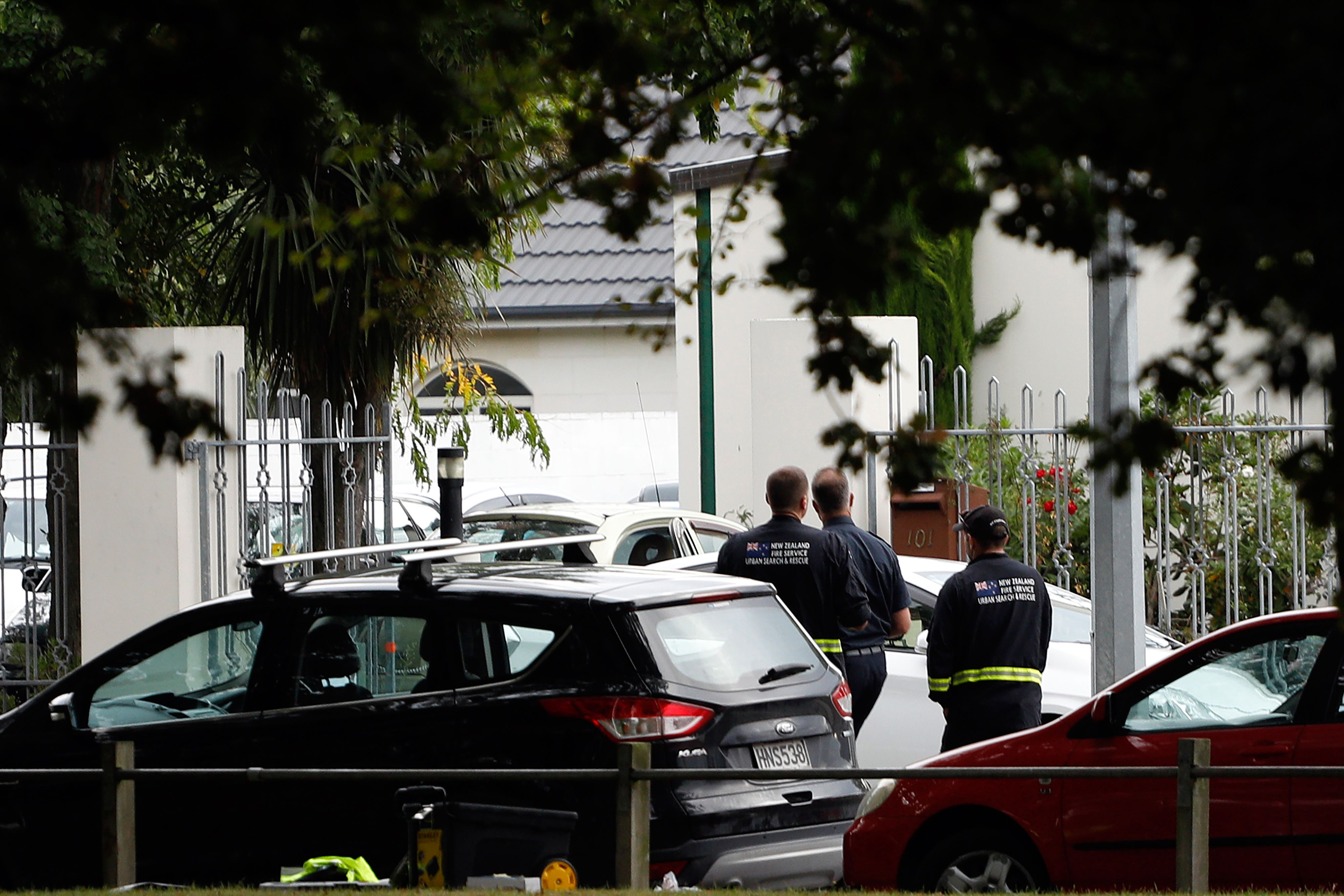 Security officials walk outside the Masjid al Noor mosque after a shooting incident in Christchurch on March 15, 2019. - Attacks on two Christchurch mosques left at least 40 dead on March 15. (TESSA BURROWS/AFP/Getty Images)