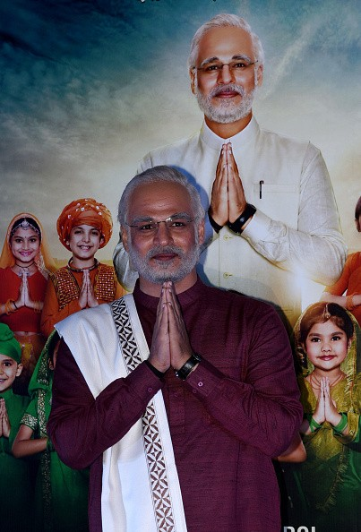 """Indian Bollywood actor Vivek Oberoi, characterised as Prime Minister Narendra Modi, gestures during the trailer launch for the upcoming biopic film """"PM Narendra Modi"""", in Mumbai on March 20, 2019. (Photo by Sujit Jaiswal / AFP)        (Photo credit should read SUJIT JAISWAL/AFP/Getty Images)"""