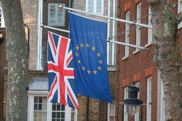 A Union Flag and an EU Flag are seen flying together in London. (Photo:  DANIEL LEAL-OLIVAS/AFP/Getty Images)