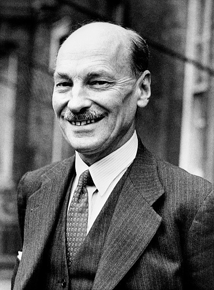 British leader of the Labour Party Clement Attlee smiles after the political campaign of the general election on February 23, 1950 in London. / AFP PHOTO / INTERCONTINENTALE / -        (Photo credit should read -/AFP/Getty Images)