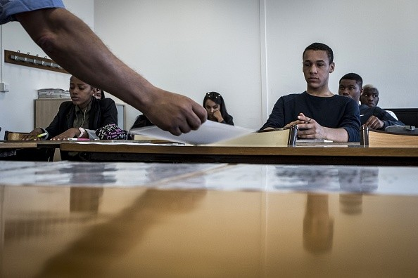 """A group campaigning for the rights of students wrongly accused of cheating have called on home secretary Sajid Javid to take steps to rehabilitate the """"tens of thousands of innocent students."""" (Photo: JEAN-PHILIPPE KSIAZEK/AFP/Getty Images)"""