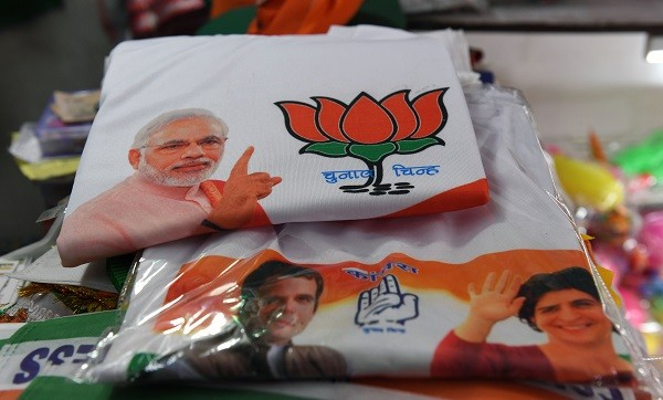 T-shirts bearing pictures of Indian prime minister Narendra Modi, Indian Congress president Rahul Gandhi and his sister Priyanka Gandhi, a Congress official in Uttar Pradesh state, are displayed at a shop in New Delhi on March 13, 2019. (Photo: MONEY SHARMA/AFP/Getty Images).