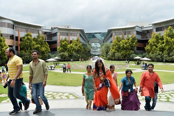 ESRC carried out a 24 month long research to find out what lessons can be learned from India to increase the number of women entering the UK's IT sector (Photo: MANJUNATH KIRAN/AFP/Getty Images).