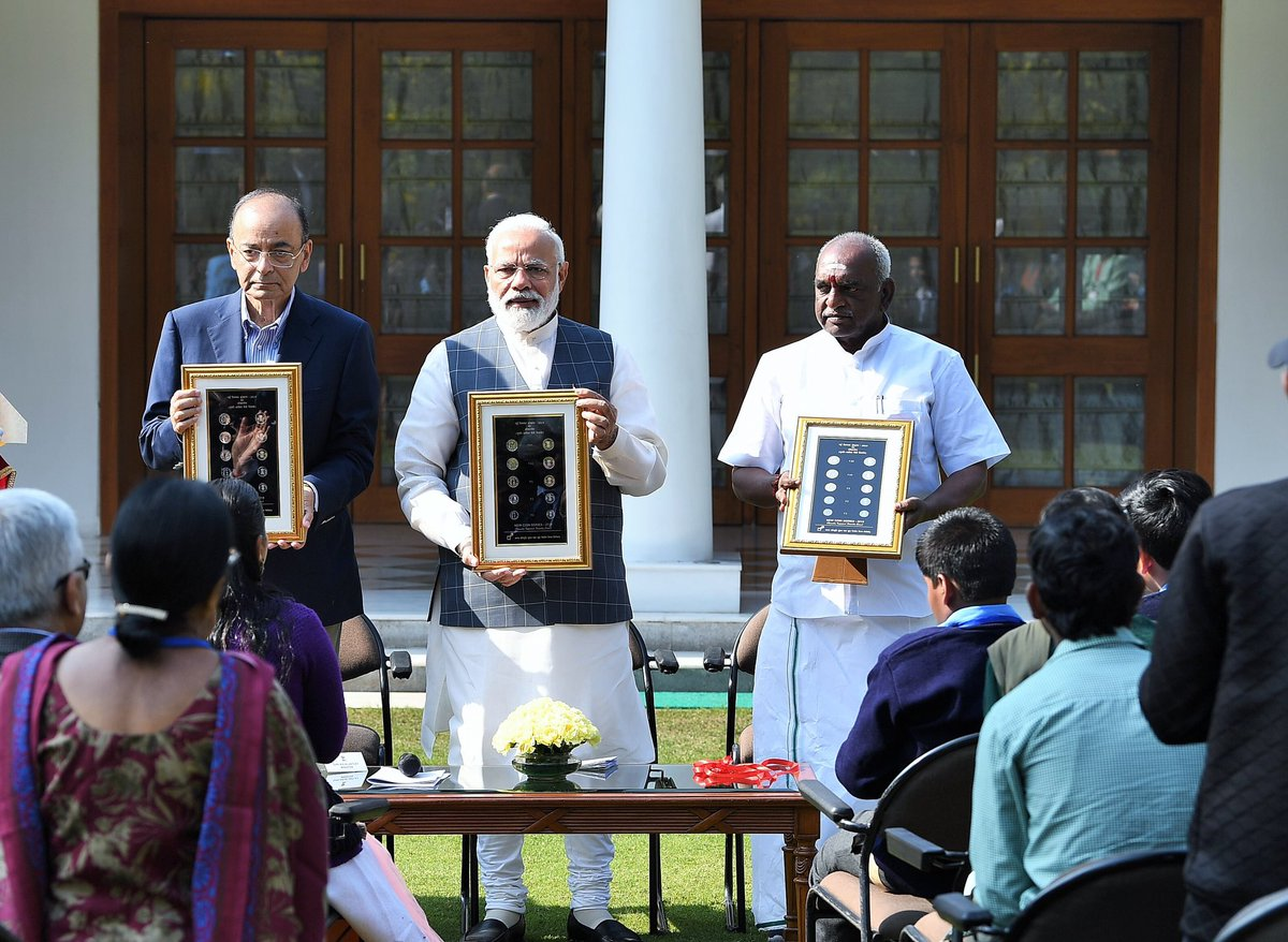 A new series of one, two, five, and ten rupee coins too will also be minted, which will be circular in design and have denominations written in the Devnagri script (Indian prime minister Narendra Modi (M) and finance minister Arun Jaitley (L), and minister Pon Radhakrishnan (R) during the event/Photo Credit: Twitter @narendramodi).