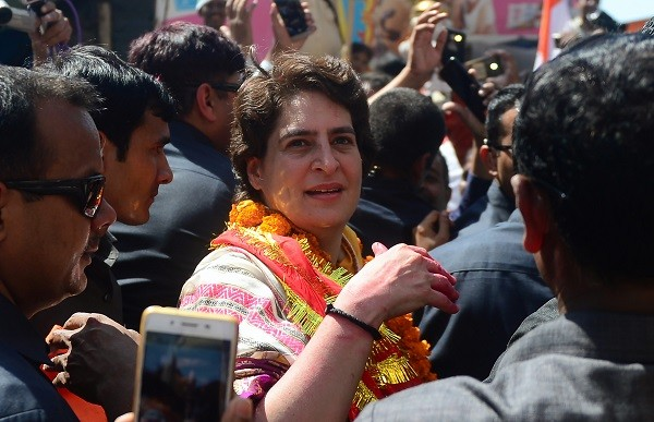 Priyanka Gandhi Vadra (C), Indian political leader and the Congress party's general secretary for eastern Uttar Pradesh, is surrounded by security, supporters and members of the media during her election campaign visit to Varanasi on March 20, 2019 (Photo: SANJAY KANOJIA/AFP/Getty Images).