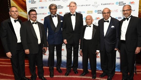 (From left) Kalpesh Solanki, T Ramachandran, Iype Abraham, Philip Hammond, Ramniklal Solanki CBE, Prakash Hinduja and Shailesh Solanki.