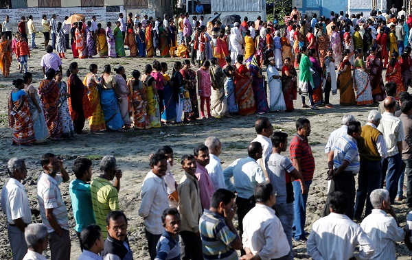 Voters line up to cast their votes outside a polling station during the first phase of general election in Alipurduar district in the eastern state of West Bengal, India, April 11, 2019. (Photo: REUTERS/Rupak De Chowdhuri)