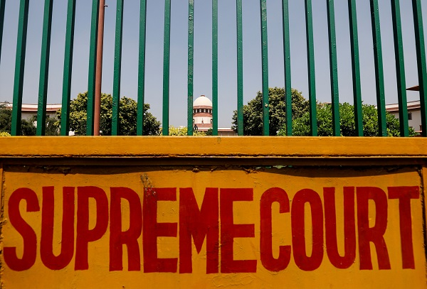 A signboard is seen outside the premises of Supreme Court in New Delhi, India. (REUTERS/Anushree Fadnavis)