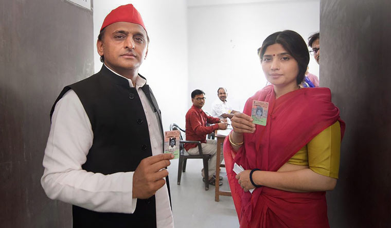 Samajwadi Party president Akhilesh Yadav and his wife Dimple Yadav before casting their votes at a polling station in Saifai on Tuesday (PTI)