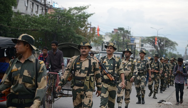 Indian Border Security Force (BSF) personnel patrol a street for the upcoming general election in Siliguri, in the Indian state of West Bengal, on April 9, 2019. - India is holding a general election to be held over nearly six weeks starting on April 11, when hundreds of millions of voters will cast ballots in the world's biggest democracy. (Photo by DIPTENDU DUTTA / AFP)        (Photo credit should read DIPTENDU DUTTA/AFP/Getty Images)
