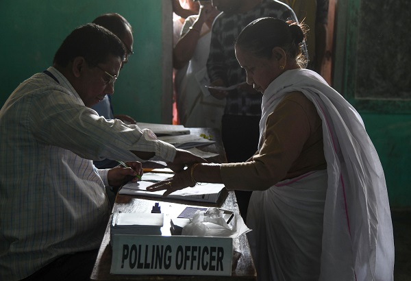 An Indian voter gives her fingerprint as she comes to cast her vote at a polling station during India's general election in Purandudam village, some 140 km from Guwahati, the capital city of India's northeastern state of Assam on April 11, 2019 (Photo: BIJU BORO/AFP/Getty Images).