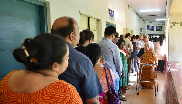 Indian voters line up to cast their ballot during the second phase of the national elections in Bengaluru on April 18, 2019 (Photo: MANJUNATH KIRAN/AFP/Getty Images).