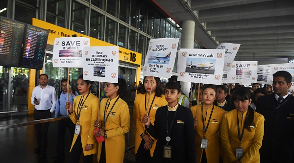 Indian employees of Jet Airways hold placards at a rally to appeal to the Indian government and lenders to bail out the airline from bankruptcy and save the jobs of thousands of its employees, at the Subhas Chandra Bose Internationa Airport in Kolkata on April 24, 2019 (Photo: DIBYANGSHU SARKAR/AFP/Getty Images).