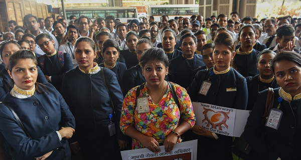 Jet Airways employees listen to their spokesperson during a protest at the Chattrapati Shivaji International airport in Mumbai on April 12, 2019 (Photo: INDRANIL MUKHERJEE/AFP/Getty Images).