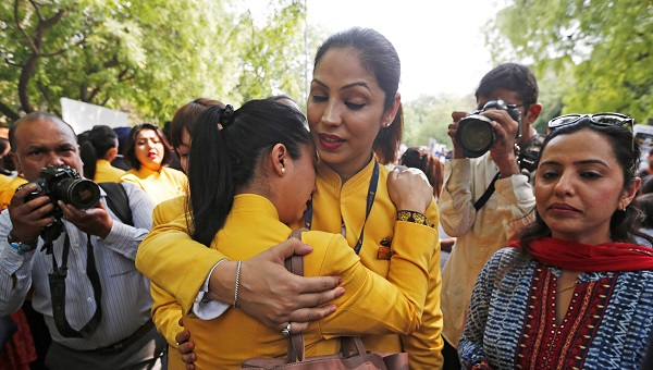 """An employee of Jet Airways is consoled by her colleagues during a protest demanding to """"save Jet Airways"""" in New Delhi, India on April 18, 2019 (Photo: REUTERS/Adnan Abidi)."""