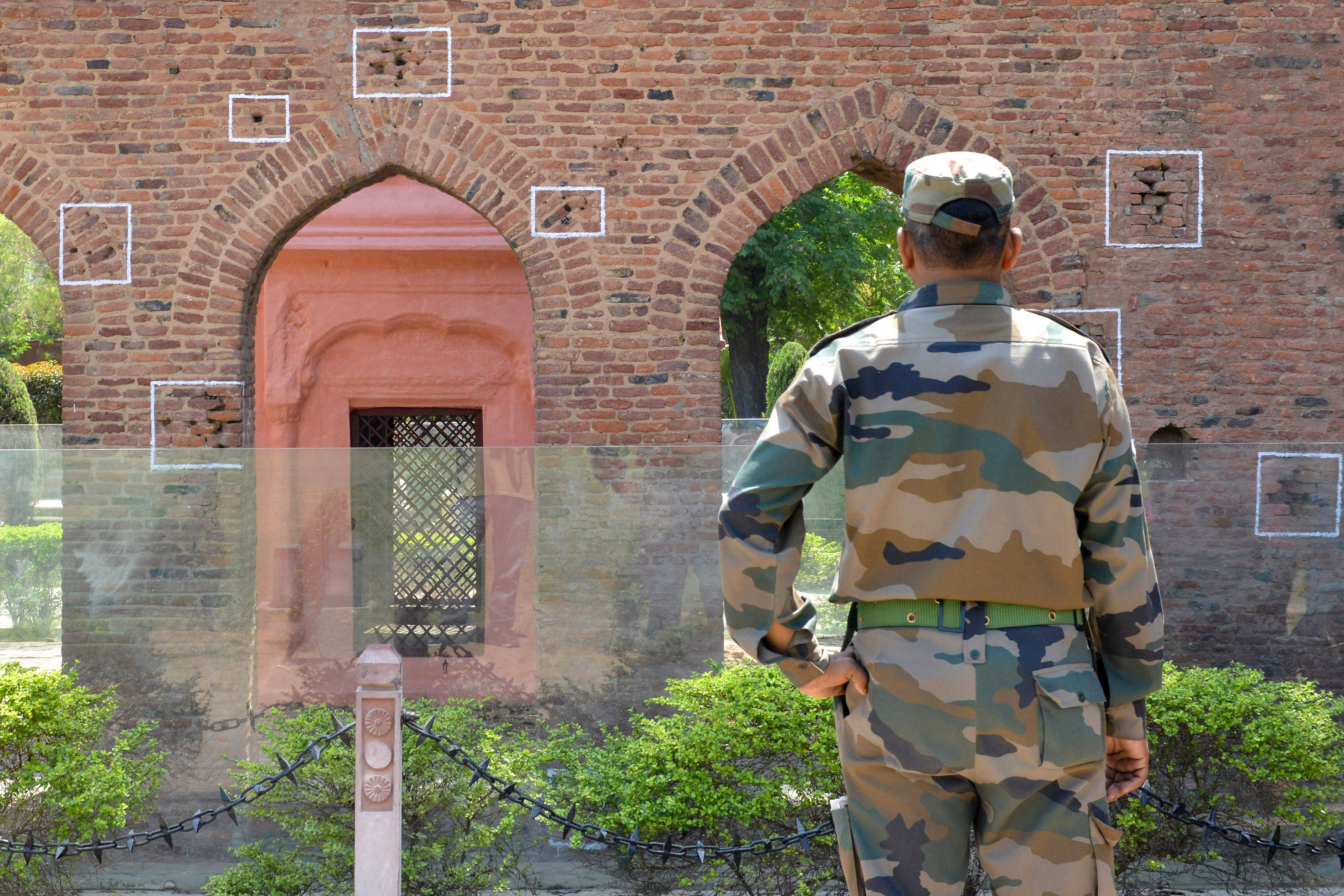 An Indian army personnel looks at the bullet marks on a wall near the Jallianwala Bagh Martyrs' Memorial ahead of the 100th anniversary of the Jallianwala Bagh massacre in Amritsar (Pic by: NARINDER NANU / AFP)