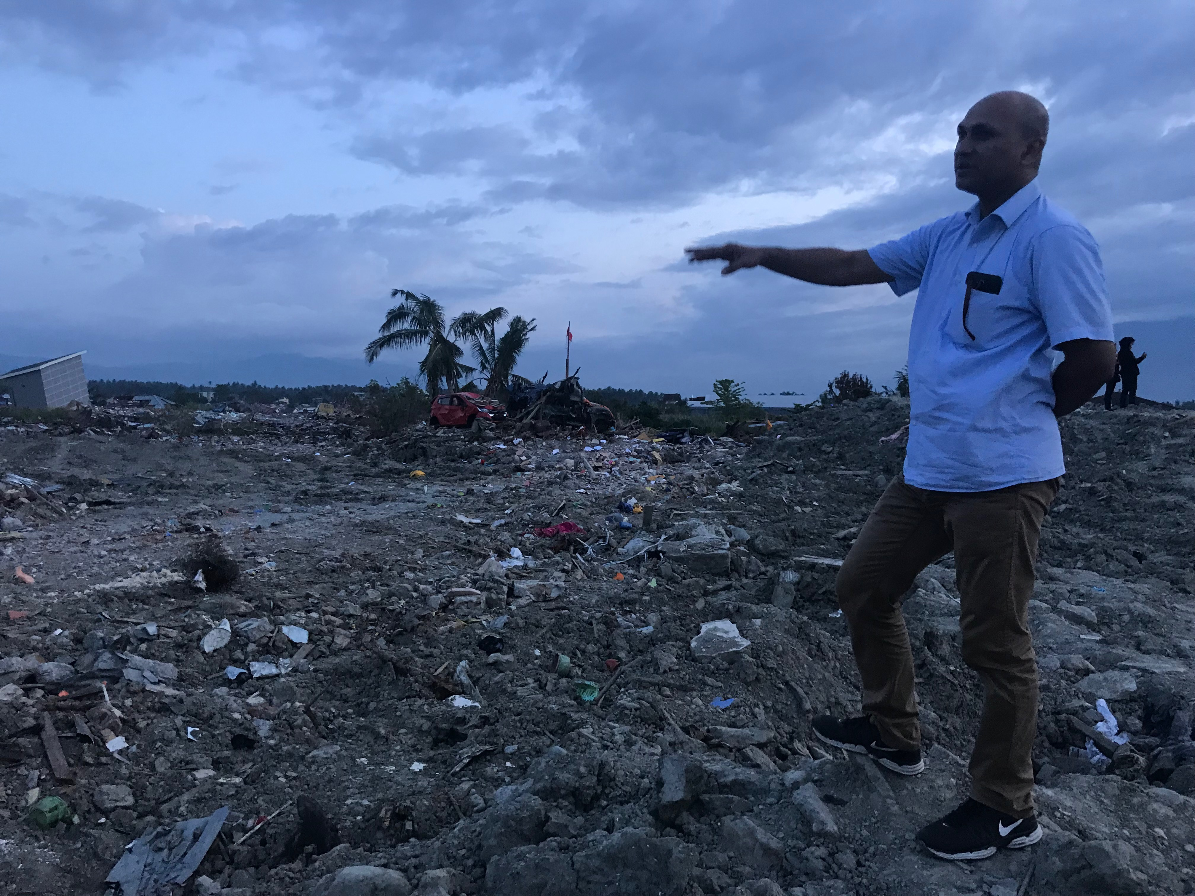 RELIEF EFFORTS: Sanjeev Bhanja looks at the damage caused by a devastating earthquake in Indonesia