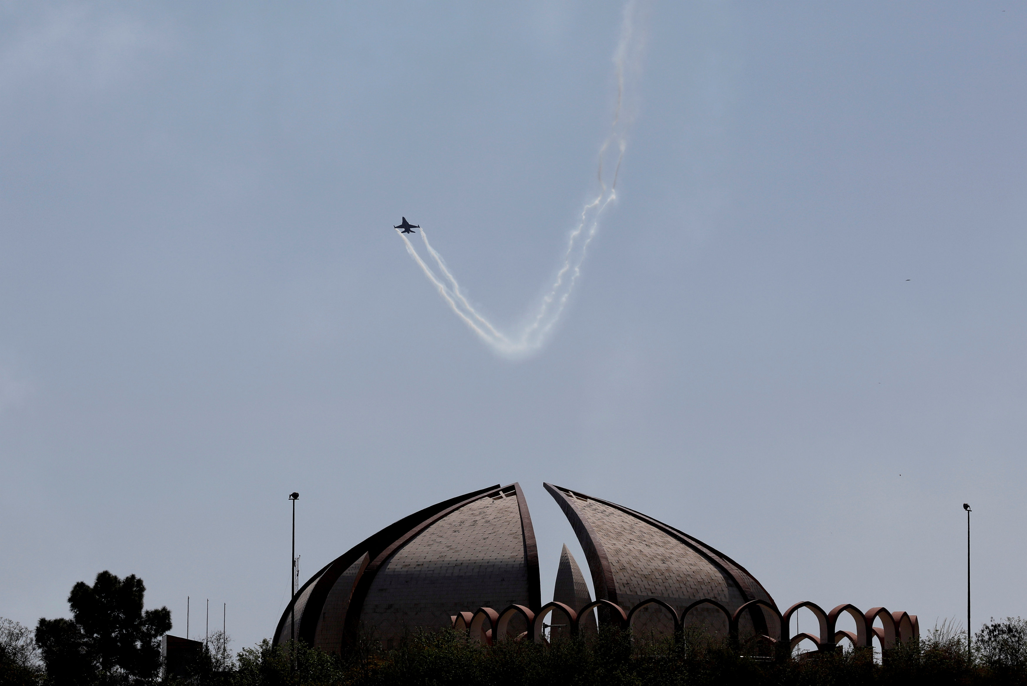 Pakistan Air Force (PAF)'s fighter jet F-16 flies over the Pakistan National Monument in Islamabad, Pakistan