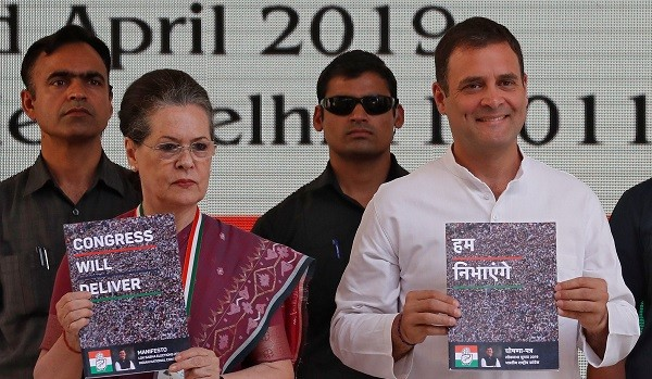 Rahul Gandhi, president of India's main opposition Congress party, and his mother and leader of the party Sonia Gandhi display copies of their party's election manifesto for the April/May general election in New Delhi, India, April 2, 2019 (Photo: REUTERS/Adnan Abidi).