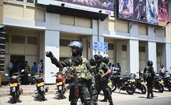 Security personnel stand guard after a controlled explosion in front of a movie theatre in Colombo on April 24, 2019, three days after a series of bomb blasts targeting churches and luxury hotels in Sri Lanka (Photo: JEWEL SAMAD/AFP/Getty Images).