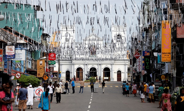 People walk near St Anthony's Shrine in Colombo, three days after a string of suicide bomb attacks on churches and luxury hotels across the island on Easter Sunday, in Sri Lanka April 24, 2019. REUTERS/Dinuka Liyanawatte