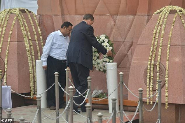 Dominic Asquith laying the wreath at the site of the Amritsar massacre