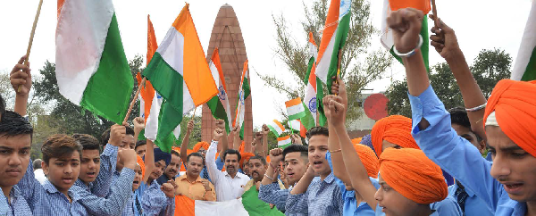 People pay tribute at the Jallianwala Bagh Martyrs' Memorial to mark the attack's centenary.