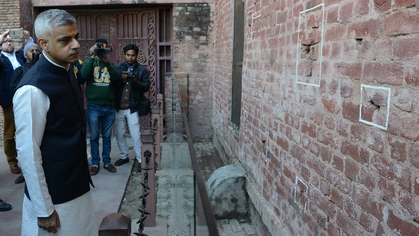 London mayor Sadiq Khan looks at the bullet marks on a wall during a visit to Jallianwala Bagh in Amritsar on December 6, 2017.