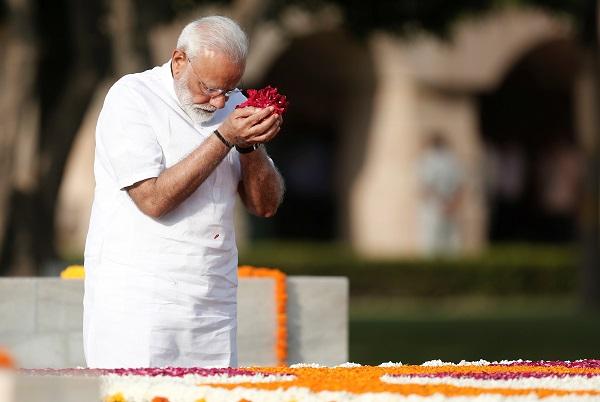 India's prime minister Narendra Modi pays his respects at the Mahatma Gandhi memorial at Raj Ghat ahead of his swearing-in ceremony, in New Delhi, India May 30, 2019. (Photo: REUTERS/Adnan Abidi)