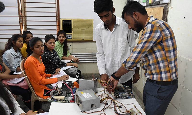 Indian youths at a class for a three-month course on computer hardware at a training centre run by the National Skill Development Corporation (NSDC) under the Ministry of Skill Development and Entrepreneurship (MSDE) in New Delhi. -  (Photo by Prakash SINGH / AFP)