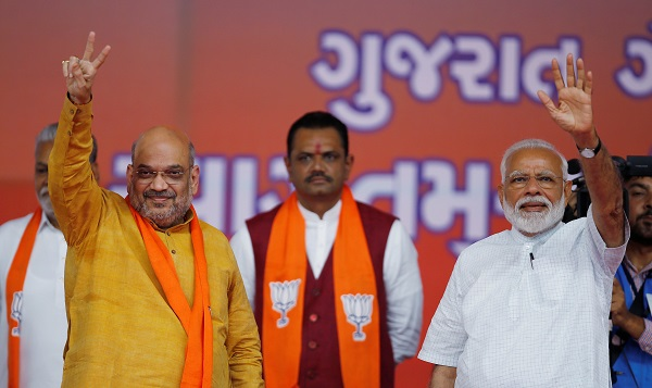 India's prime minister Narendra Modi and Bharatiya Janata Party (BJP) president Amit Shah wave toward their supporters at a public meeting in Ahmedabad, India, May 26, 2019 (Photo: REUTERS/Amit Dave).