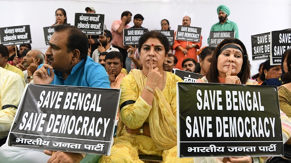 Supporters of the Bharatiya Janata Party (BJP) take part in a silent protest rally in New Delhi on May 15, 2019, following clashes between BJP supporters and the opposition Trinamool Congress (TMC) in Kolkata (Photo: SAJJAD HUSSAIN/AFP/Getty Images).