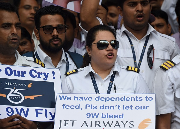 India's Jet Airways employees hold placards during a protest in Mumbai on May 8, 2019. Debt-stricken Jet Airways halted all of its operations last month after failing to secure emergency funding from lenders (Photo: PUNIT PARANJPE/AFP/Getty Images).