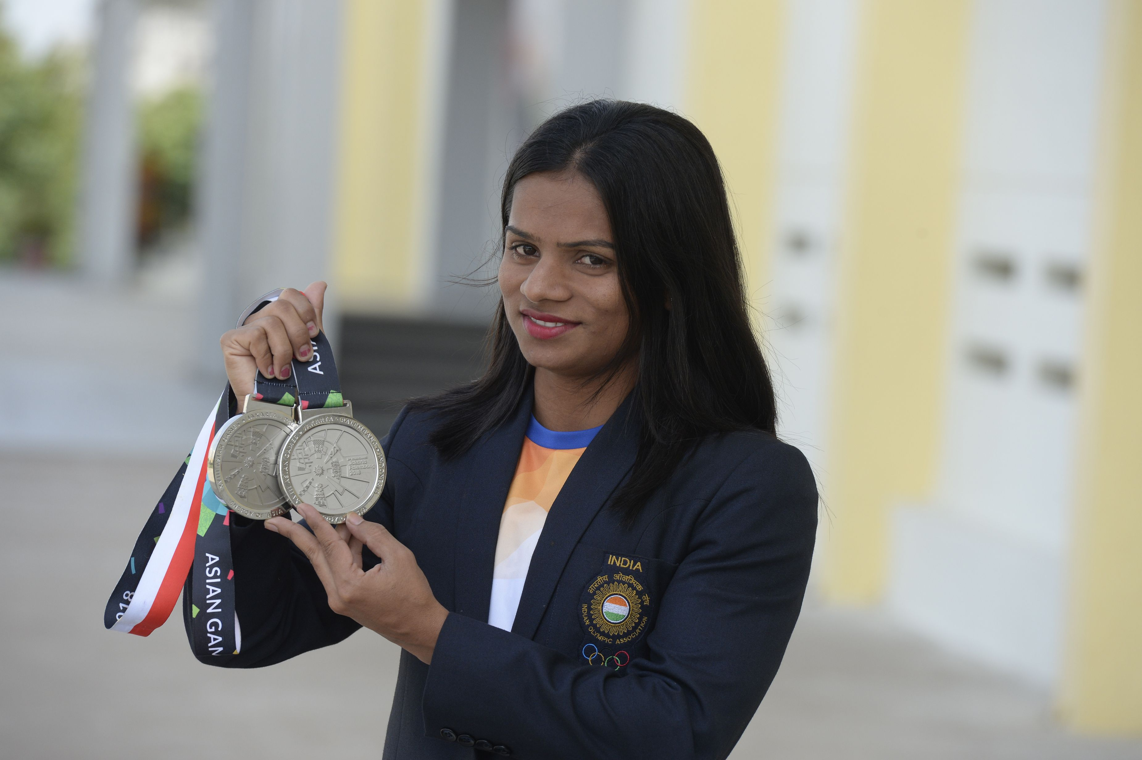Indian sprinter Dutee Chand poses with her silver medals prior to a press conference in Hyderabad on September 1, 2018. - Dutee Chand won silver medals in 100m and 200m athletics event during the 2018 Asian Games in Jakarta. (Photo by NOAH SEELAM / AFP)        (Photo credit should read NOAH SEELAM/AFP/Getty Images)