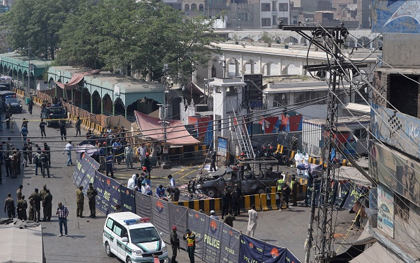 Pakistani security officials cordon off the site of a bomb blast outside a Sufi shrine in Lahore on May 8, 2019. - A blast at one of Pakistan's oldest and most popular Sufi shrines killed at least five people and wounded 24 in the eastern city of Lahore May 8, police said, as the country marks the fasting month of Ramadan. (Photo: ARIF ALI/AFP/Getty Images)