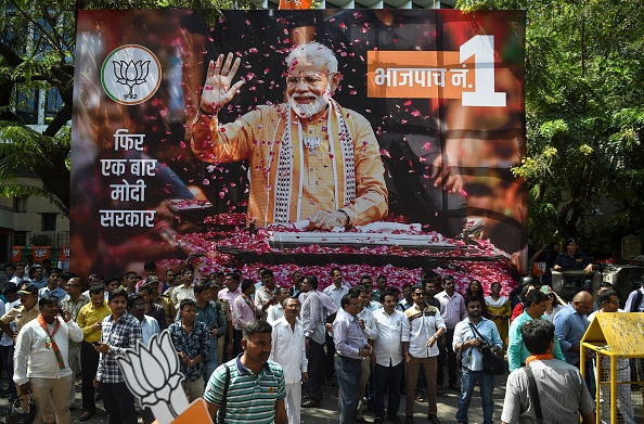 Supporters of Indian prime minister Narendra Modi and his ruling Bharatiya Janata Party (BJP) gather to celebrate on the election results day outside the BJP headquarters in Mumbai on May 23, 2019.  (Photo: PUNIT PARANJPE/AFP/Getty Images)